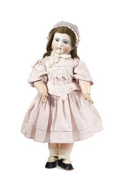 Early Belton-type bisque head doll With fixed blue glass eyes, finely painted lashes and brows, open/closed mouth and pierced ears. long brown wig and on a fully jointed wood and composition Jumeau body, wearing a pink dress, bonnet and black shoes, (body incorrect), 56cm (22in) tall.