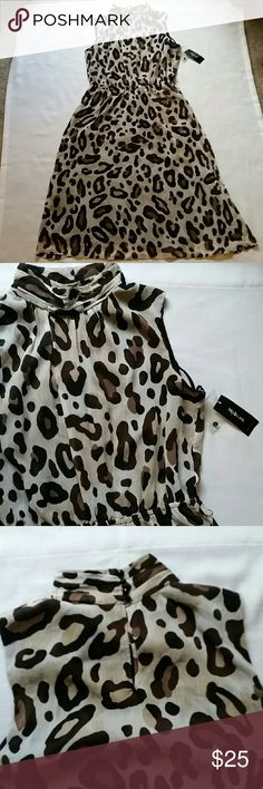 Style & co. Sleeveless Animal Print Dress Size : 14  Fabric: Outer fabric and lining are 100 % Polyester   Condition: Excellent (New with tags)  Additional details: Back neckline buttons with four black pearls.  This dress is simply gorgeous! It would be a perfect addition to your fall wardrobe.  Pair this beauty with a cream cardigan or cocoa brown cropped leather jacket.  Honestly,  the options are limitless with this piece! Style & Co Dresses