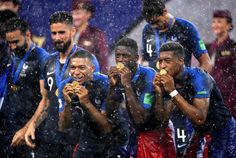 Kylian Mbappe, Ousmane Dembele and Presnel Kimpembe of France celebrate victory follwing the 2018 FIFA World Cup Final between France and Croatia at Luzhniki Stadium on July 2018 in Moscow, Russia. World Cup Russia 2018, World Cup 2018, Fifa World Cup, World Cup Final, Croatia, Victorious, Soccer, July 15, Moscow Russia