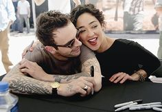 Joseph Gilgun and Ruth Negga.  Looks like they've had a long day signing autographs!
