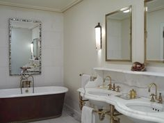 Kathryn Scott Design Studio: Gorgeous bathroom with marble double washstand with antique brass base and antique brass ...