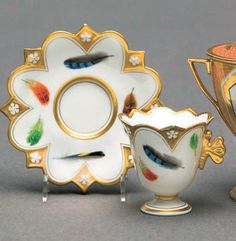 Barr, Flight & Barr...Cabinet Cup and Saucer with multi-colored feathers and gold gilt trim...circa 1810