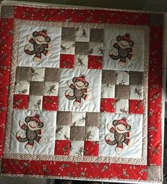 Beverly Adams stitched out this cute quilt! Sock Monkey Applique Too is… Baby Patchwork Quilt, Baby Boy Quilts, Children's Quilts, Amish Quilts, Quilting Projects, Quilting Designs, Sewing Projects, Quilt Design, Country Quilts