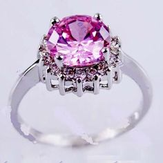 'size 8 Pink Sapphire White Gold Filled Ring' is going up for auction at  3pm Thu, Sep 20 with a starting bid of $5.