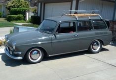This 1967 VW Squareback has recently been restored and runs a 2.0 Porsche 914 motor. It looks nice in a period looking greenish gray and lowered over red center steelies with hubcaps,