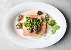 Poached Wild Salmon with Peas and Morels  This simple yet luxurious preparation is delicious with fresh wild king salmon, though you can use any of your favorite salmon varieties
