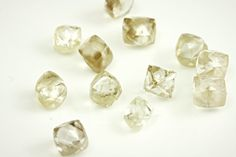 Beautiful natural rough diamonds in various shades of champagne, cream, and chocolate browns.