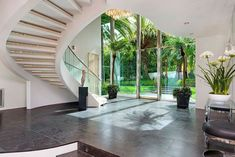 Contemporary Staircase with High ceiling, slate tile floors