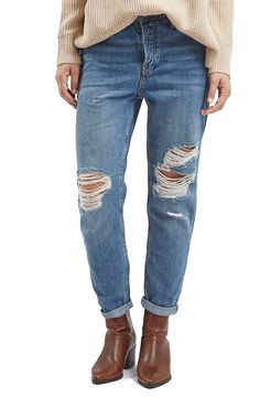 These distressed boyfriend jeans are sure to transition effortlessly through the seasons.