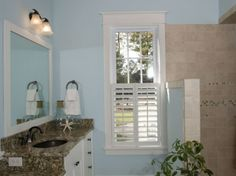 Plantation shutter and molding. Want to do this to all my downstairs windows. Get rid of my brown wood blinds.