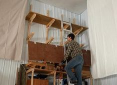 Way-up-high cantilevered garage shelves Garage Storage Shelves, Garage Tool Organization, Building Garage Shelves, Garage Shelf, Garage Tools, Garage Workshop, Cantilever Shelf, Touch Screen Laptop, Cheap Storage