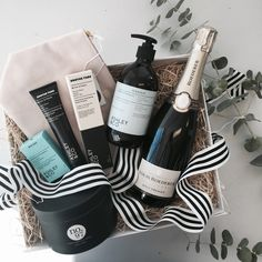 She's going to feel spoiled rotten with this beautiful gift. Filled with everything every girls wants it includes:  - Louis Roederer Brut Premier  - Milk & Sugar Large Wash bag in Blush  - Ashley & Co Bubbles & Polkadots Wash Up Liquid Hand Soap  - Ashley & Co Bubbles & Polkadots Mini Bar Soap  - Ashley & Co Mortar & Pestle Soothe Tube Hand Cream  - No. 97 Green Tea & Lemongrass Soy Wax Candle   Packaged in an exclusive Gifting Co box with black & white stripped grosgrain ribbon & swing tag.