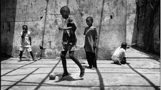 footynions:  Street kids play ball in Monrovia, Liberia.