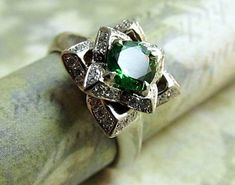 Hey, I found this really awesome Etsy listing at http://www.etsy.com/listing/173830819/lotus-engagement-ring14k-white-gold