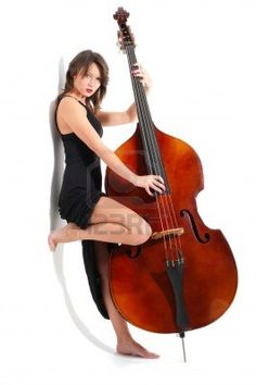Young woman in black dress play double bass isolated on white Stock Photo