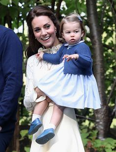 Little Princess Charlotte looked simply adorable in a £74 pale blue frock with pink smocking and a peter pan collar from Pepa & Co. Her dress was styled with a matching blue knit cardigan from Spanish brand Mi Lucero and cute little pumps.
