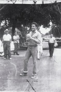 """When Elvis came to town- during fliming of """"Follow That Dream"""" - Elvis Presley plays football outside the Inverness, Fl courthouse in August, 1961, during the making of the movie, """"Follow That Dream."""" In between takes, Elvis and the crew played ball in a blocked off street. Local resident Frances Castel remembers watching him from his office and """"foaming at the mouth."""" - See more at: http://www.pbpulse.com/news/entertainment/movies/label-florida-travelwhen-elvis-came-to-town51-"""