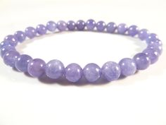 Tanzanite Stretch Bracelet 6mm Smooth Round Tumbled Bead Violet Flame Gemstones by SandiLaneFineArt on Etsy