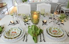 This is an awesome summer dinner tablescape that is lit by candlelight