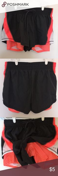 NWOT- Champion double-layer running shorts These have a fluorescent orange spandex undershort with a nylon grey overshort. Very soft. Elastic + drawstring. Adult medium.   Never ever worn. I bought these for my teen & stuck them in her closet in the hopes that she would wear proper clothes during gym class & not denim cut-offs. You know how some fashion-obsessed teens are. She never wore these. (Sometimes the closet trick works on loved ones, sometimes it doesn't.) Champion Shorts