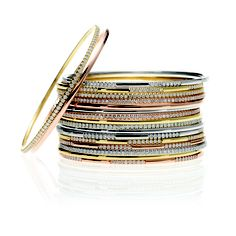 Stack of gold and diamond bangles.