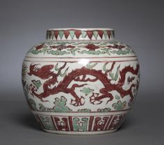 Jar with Dragons Pursuing Flaming Jewels, 1522-1566, China, Jiangxi province, Jingdezhen kilns, Ming dynasty (1368-1644), Jiajing mark and reign (1521-1566), porcelain with wucai (five color) overglaze enamel decoration, Diameter - w:14.70 cm (w:5 3/4 inches) Overall - h:12.90 cm (h:5 1/16 inches). Bequest of Mrs. Severance A. Millikin 1989.291, Cleveland Museum of Art