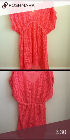 Swim suit cover up FINAL PRICE--This eye catching neon coral swimsuit cover up is perfect for the pool or beach! There is an elastic band under the bust. I wore it for one summer. The bathing suit is for sale as well in a separate listing. Bundle and save! Swim