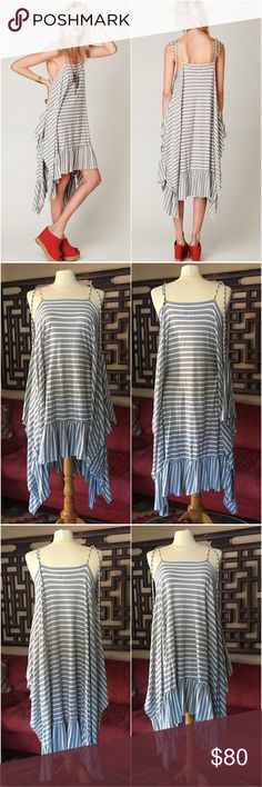 FP Beach Striped Babe Blanket Dress Striped blanket dress with layered ruffle hem and bow tie straps. High slits on sides. High-low hem. Two connecting ties inside. Semi-sheer.  Excellent pre-loved condition. There are a couple of very faint discolorations on the ruffle hem, so faint that I actually couldn't find them when photographing the dress.  The 2nd photo shows the silhouette with the ties tied inside, while they are untied in the 3rd photo. Free People Dresses