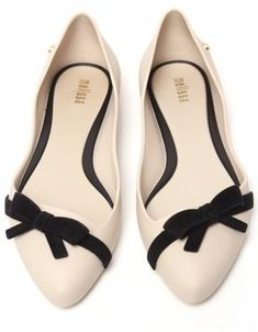 If Tammy was forced to wear flats it would be something like this...Ivory flats wiith black bow accent detail