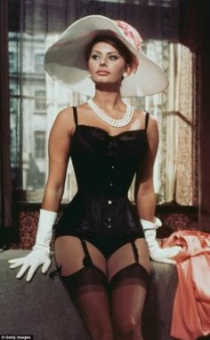 This is one of my favorite photos of Sophia Loren. This one picture is the embodiment of what she was known for - sexy, womanly, beautiful, yet still utterly classy.