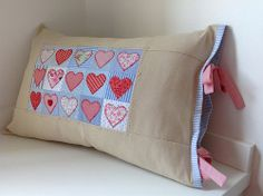 New way to display those sweet heart quilts.