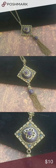 """Boho Pendant & Tassel Drop Necklace 30"""" Antiqued Brass Chain w/ lobster clasp closure Diamondshaped Deco Pendant w/Red Cobochon & Crystal Accents. Finished with a bead & brass chain tassel. Item#N611 ALL JEWELRY IS NWT/NWOT/UNUSED VINTAGE  **REASONABLE OFFERS ACCEPTED** 25% OFF BUNDLES OF 3 OR MORE ITEMS! BUY WITH CONFIDENCE~ TOP 10% SELLER, SAME DAY SHIPPING,  5 STAR RATING! FREE GIFT(S) WITH MOST ORDERS. Colette Hayman  Jewelry Necklaces"""