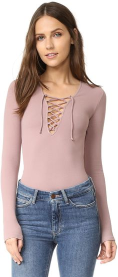 Free People Lace Up Layering Top - Thin ties lace up the split neckline of this formfitting Free People top. Long sleeves.      Fabric: Ribbed jersey.     92% nylon/8% spandex.     Wash cold.     Made in the USA.