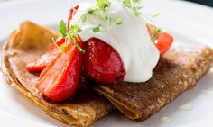 Buckwheat crepe - Strawberries, agave syrup & lemon balm. At Great Northern Hotel London, UK. Exquisitely designed luxury boutique hotel with an extraordinary location, offering unrivaled value to the discerning traveler. By Hotelied.