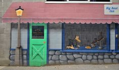 Back of the Big Boot Inn. Kamloops, BC. I like the way that the artist put his name into the mural.