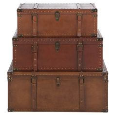 Set of three aged leather and wood trunks.  Product: Small, medium and large trunk  Construction Material: Wood and ag...