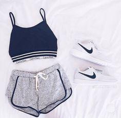 Calvin Klein sports bra/shirt, gray shorts, white nike roshe