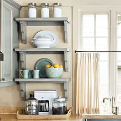 Organize Your Kitchen | Shelves | SouthernLiving.com  Great idea for corner space without using a corner cabinet and a skinny cabinet