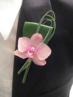Pink phalenopsis orchid boutonniere. #WeddingFlowers #Boutonniere