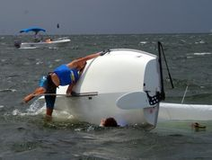 What skinny kids have to learn to do while trying to learn how to sail lasers. :-)