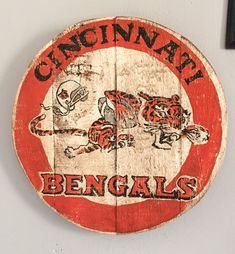 Hand painted 1960s Cincinnati Bengals logo sign/plaque on recycled lumber and waxed to look vintage. Roughly 11 diameter.  Made to Order. Please