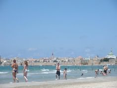beach in Nahariya with the city of Akko in the background, Northern Israel. Summer 2009