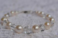One strand of graduated sizes (6-10mm), gorgeous, luxurious and lustrous creamy white Freshwater Pearls are combined with Genuine Swarovski crystals, graduated sizes (6-12mm). These Freshwater pearls are round, AAA quality and have gorgeous luster. A Sterling Silver Lobster clasp