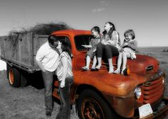 Family with old truck