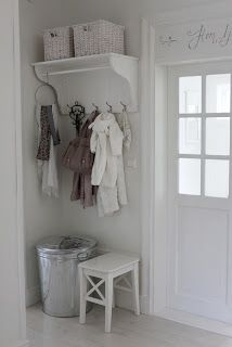 Good idea for back door entry.  Metal can can hold gloves, scarves and wintry hats!