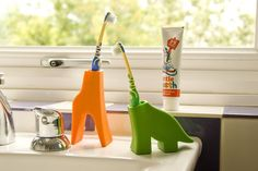 A holder that turns your toothbrush into a giraffe or a dinosaur.