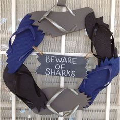 Shark party wreath.Awesome shark week projects and crafts. sandandsisal.com