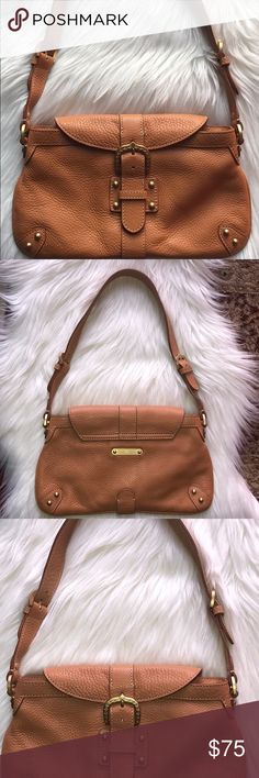 Dooney & Bourke shoulder bag Like new calf skin leather bag with zipper top and buckle on the front flap. 11 1/2 inches long and 6 1/2inches high. Zipper pocket inside and a small pocket for small phone and key fob. Dooney & Bourke Bags Shoulder Bags