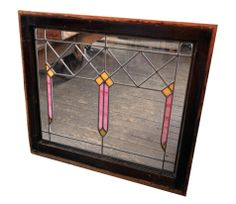 Really cute pink and orange stained glass prairie window