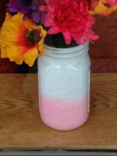 Mason jars coloered w glue an food coloring.